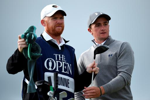 Ireland's Paul Dunne of Ireland and caddie Alan Murrey look on from the 6th tee during the first round of the 144th Open Championship at The Old Course in St Andrews