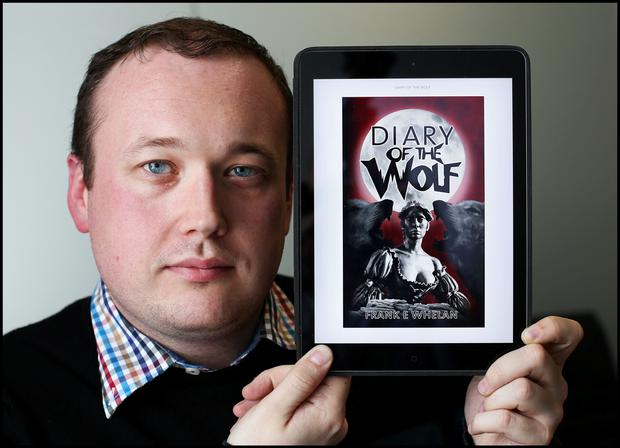 Frank Whelan with the cover of his book 'Diary of the Wolf'. Pic Steve Humphreys 14th July 2015.