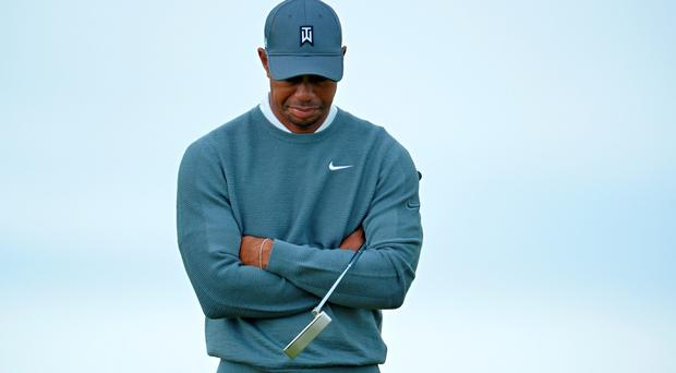 US golfer Tiger Woods waits on the 11th green during his first round 76