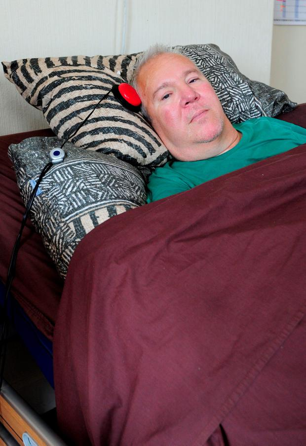 Paralysed road accident victim Paul Lamb, at home in Leeds, West Yorkshire Credit: Anna Gowthorpe/PA Wire
