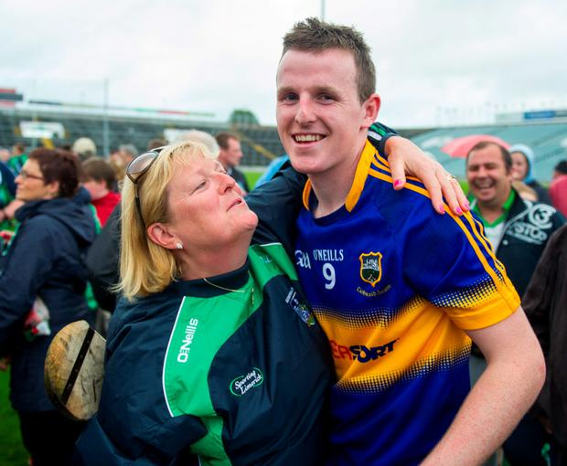 Jean Dempsey congratulates her son David after the game
