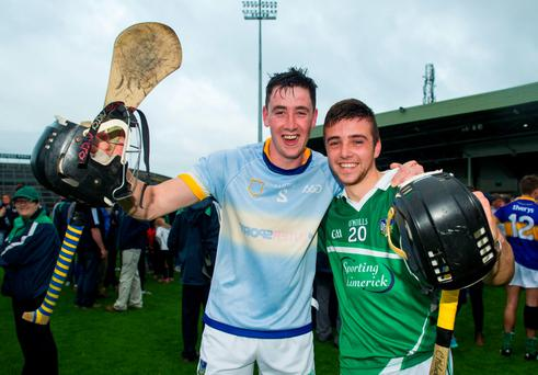 Limerick captain Diarmuid Byrnes, left, and Colin Ryan, celebrate after the game