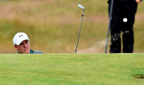 US golfer Jordan Spieth plays from a bunker on the 17th hole during his first round 67, on the opening day of the 2015 British Open Golf Championship on The Old Course at St Andrews (Getty Images)