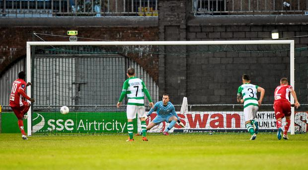 Olivier Occean, Odds Ballklubb, scores a penalty and his side's first goal past Craig Hyland, Shamrock Rovers
