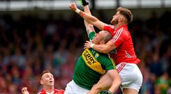 Eoin Cadogan beats Kieran Donaghy to a high ball during the drawn Munster final. Cadogan will be delighted if Kerry adopt the same tactics with Donaghy tomorrow