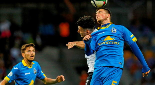 15 July: Richie Towell, center, Dundalk, in action against Evgeni Yablonski, Bate during the UEFA Champions League, Second Qualifying Round, First Leg, Bate v Dundalk