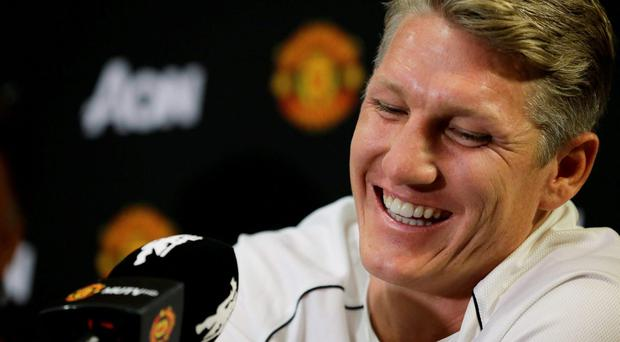 Bastian Schweinsteiger smiles as he talks to reporters after being introduced as a new singing with Manchester United, during a news conference on Wednesday, in the United States