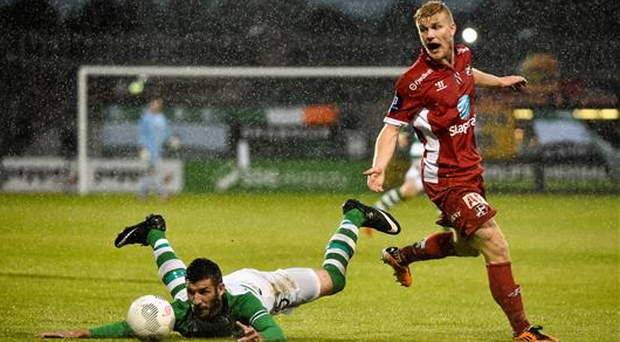 Gavin Brennan, Shamrock Rovers, in action against Emil Jonassen, Odds Ballklubb