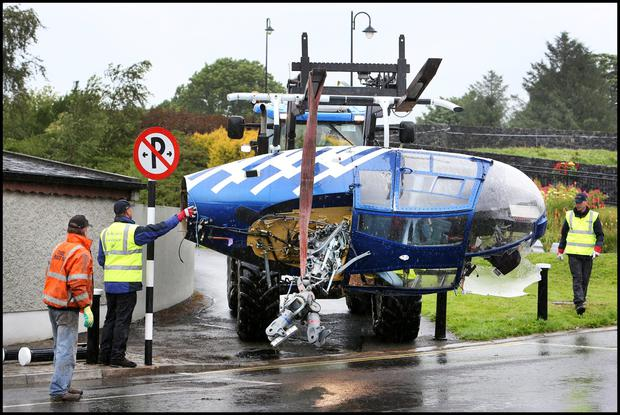 Removing the helicopter from the crash site at the Rustic Inn pub in Abbeyschrule Longford.