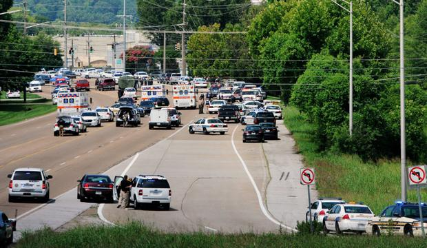 Dozens of police and emergency vehicles crowd Amnicola Highway after a morning shooting at the Naval and Marine Reserve Center at the Chattanooga Riverpark in Chattanooga, Tenessee July 16, 2015. Four U.S. Marines were killed on Thursday by a gunman who opened fire at two military offices in Chattanooga, before being fatally shot in an attack officials called a brazen act of domestic terrorism. REUTERS/Tim Barber/Chattanooga Times Free Press FOR EDITORIAL USE ONLY. NOT FOR SALE FOR MARKETING OR ADVERTISING CAMPAIGNS. NO ARCHIVES. NO SALES. MANDATORY CREDIT