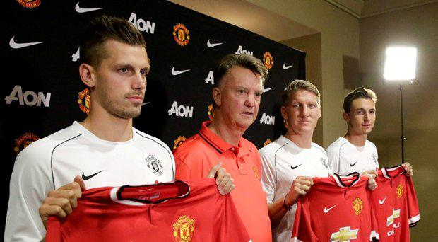 Manchester United manager Louis van Gaal (2nd L) introduces three new signings: Morgan Schneiderlin (L-R), Bastian Schweinsteiger , and Matteo Darmian, at a press conference in Bellevue, Washington July 15, 2015. REUTERS/Jason Redmond