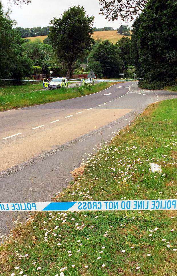Police at the scene where a man was stabbed to death by another motorist in Findon, West Sussex, following a crash.