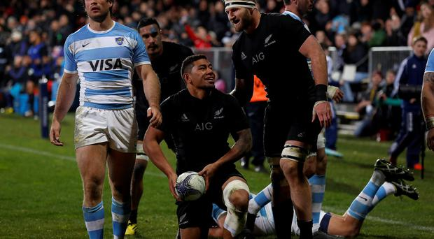 Charles Piutau of New Zealand's All Blacks celebrates scoring a try against Argentina with Kieran Read during their Rugby Championship match at AMI Stadium in Christchurch, July 17, 2015. REUTERS/Anthony Phelps