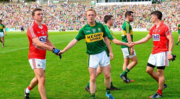 Colm Cooper, Kerry, shakes hands with Mark Collins, Cork, after the game ended in a draw