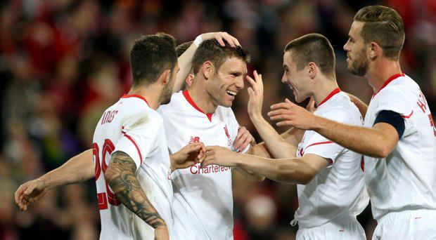 Liverpool's James Milner celebrates with team mates after scoring the second goal for his side