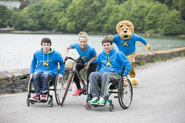 TV personality Kathryn Thomas was on hand to help launch the annual Skibbereen Charity Adventure Race (SCAR) at Lough Hyne near Skibbereen. Pictured L-R Jamie Wall, Kathryn Thomas & Nathan Kirwan (Helpful Steps) Pic. Emma Jervis