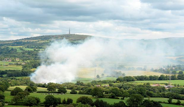Smoke billows from Wood Flour Mills in Bosley, near Macclesfield, after an explosion and fire may have left four people trapped Credit: Martin Rickett/PA Wire