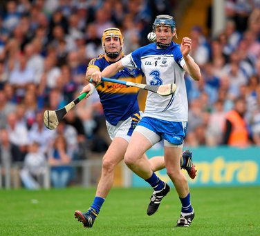 Waterford's Austin Gleeson steals a march on Tipperary's Seamus Callanan, who played a patient game in the Munster final