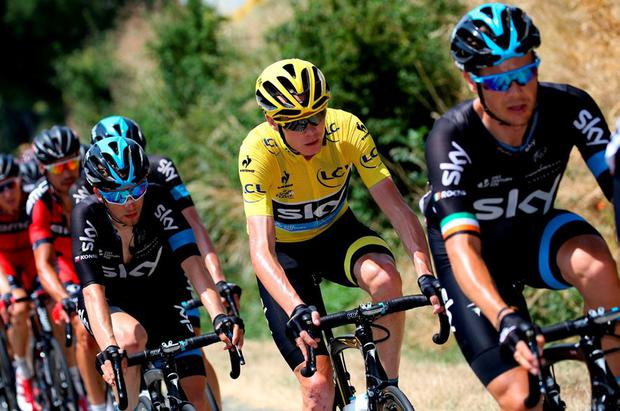 Team Sky s Nicolas Roche leads the yellow jersey of Chris Froome during  yesterday s Stage 13 of f6ce68dcb