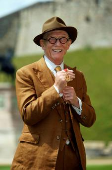 British actor John Hurt displays his knighthood awarded by Queen Elizabeth II at Windsor Castle