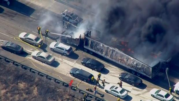 Cars shown burning on the Interstate 15 freeway in California Credit: Reuters/NBCLA.com