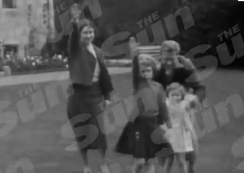 The footage allegedly shows the Queen performing the salute as a young child while 'playing' with her family