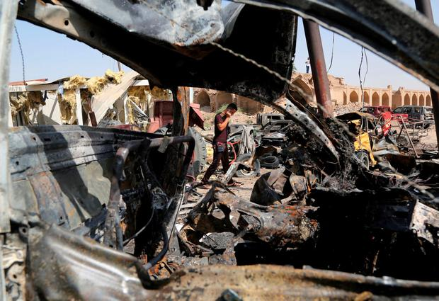 Friday's nighttime car bombing was one of the deadliest single attacks in Iraqi in the past decade Credit:AP Photo/Karim Kadim)