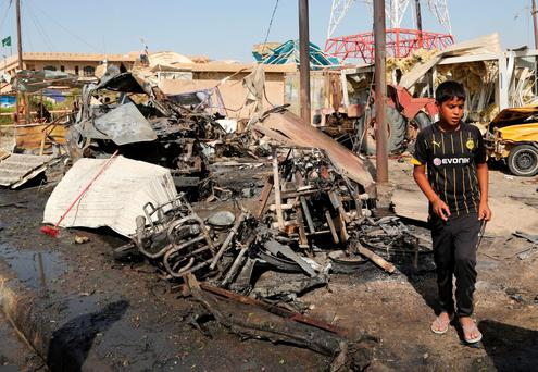 The attack by Islamic State killed over mostly-Shiite victims Credit: AP Photo/Karim Kadim