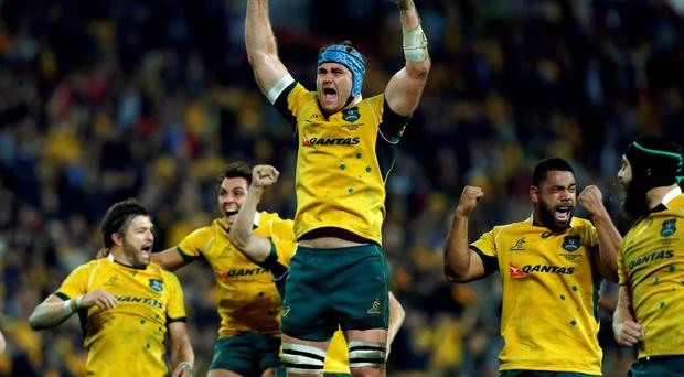 Australia's Wallabies lock James Horwill reacts with teammates after a controversial try by Tevita Kuridrani was allowed, giving them a win in the last minute against South Africa's Springboks during their Rugby championship match in Brisbane, July 18, 2015. REUTERS/Jason Reed