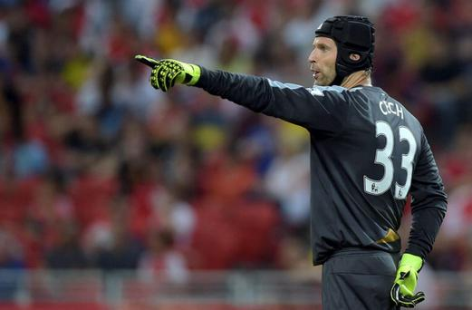 Arsenal's new goalkeeper Petr Cech directs his teammates during their match against Everton in the of the Barclays Asia Trophy soccer final in Singapore, Saturday, July 18, 2015.(AP Photo/Joseph Nair)