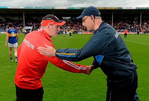Tyrone manager Mickey Harte and Tipperary manager Peter Creedon exchange a handshake after the game.
