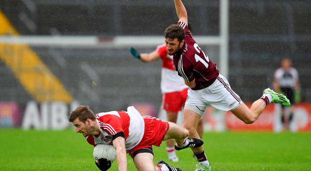 Derry's Niall Holly in action against Michael Lundy of Galway at Pearse Stadium, Salthill, Co. Galway. Picture credit: Paul Mohan / SPORTSFILE