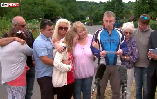 Video grab taken from Sky News of Donald Lock's son Andrew (centre right) reading out a tribute after Donald Lock, 79, was stabbed repeatedly in an apparent road rage attack after a minor crash with another car. Sky News/PA Wire