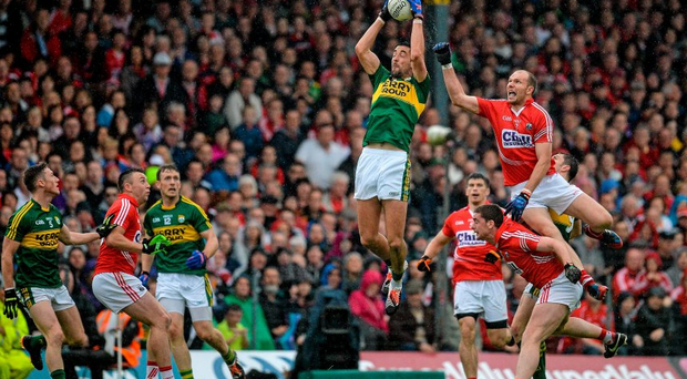 Kerry's Anthony Maher fields the ball ahead of Alan OConnor, Cork.