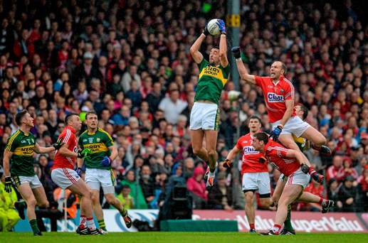 Anthony Maher, Kerry, fields the ball ahead of Alan O'Connor, Cork during the Munster GAA Football Senior Championship Final Replay (Brendan Moran / Sportsfile)