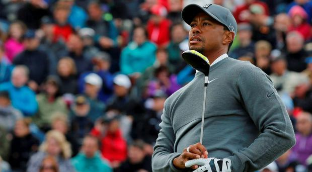 Tiger Woods of the U.S watches his tee shot on the 17th hole during the first round of the British Open golf championship on the Old Course in St. Andrews, Scotland, July 16, 2015.