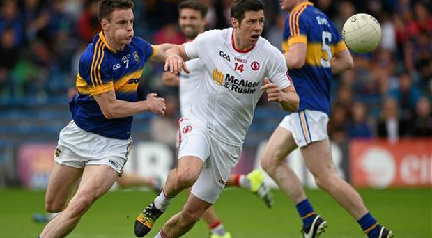 Sean Cavanagh, Tyrone, in action against Alan Campbell, Tipperary