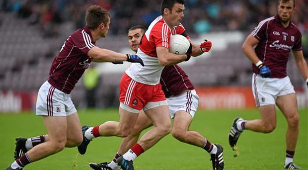 Eoin Bradley, Derry, in action against Liam Silke, left, and Cathal Sweeney, Galway