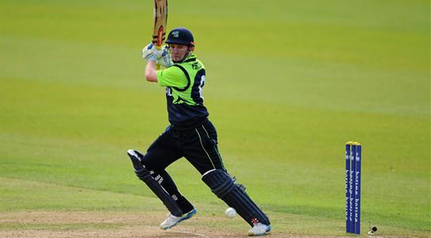 Ireland's William Porterfield scores a run off a delivery from Hong Kong's Irfan Ahmed