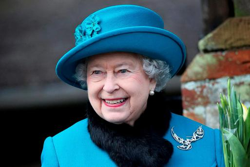 Buckingham Palace is considering legal action over the leaking of film footage showing the Queen and her mother performing a Nazi salute.