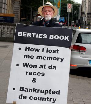 MAKING HIS VIEWS KNOWN: A man protests outside the Banking Inquiry last week. Photo: Tom Burke
