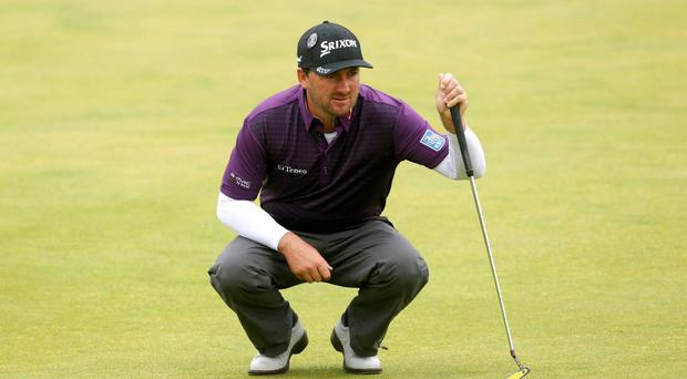 Graeme McDowell lines up a putt on the 1st green during day four of The Open Championship 2015 at St Andrews, Fife.