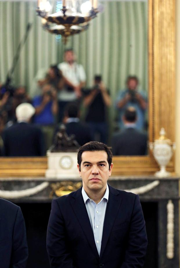 REFILE - CLARIFYING BYLINE Greek Prime Minister Alexis Tsipras looks on during a swearing in ceremony of members of his government at the Presidential Palace in Athens, Greece, July 18, 2015. New ministers in Greek Prime Minister Tsipras' government were sworn in on Saturday after a reshuffle expelled dissidents from his cabinet and began a new phase of negotiations for a third bailout package. REUTERS/Alkis Konstantinidis