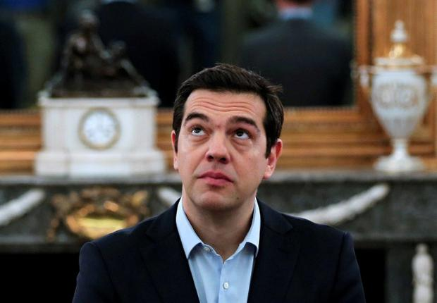 Greek Prime Minister Alexis Tsipras looks on during a swearing in ceremony of members of his government at the Presidential Palace in Athens, Greece July 18, 2015. New ministers in Greek Prime Minister Tsipras' government were sworn in on Saturday after a reshuffle expelled dissidents from his cabinet and began a new phase of negotiations for a third bailout package. REUTERS/Alkis Konstantinidis