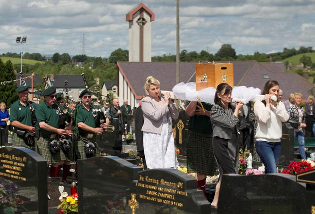 Mourners carry the remains of Catherine Burns to the graveyard after the funeral mass at Clonoe Chapel, Coalisland, after she was murdered in America 183 years ago and her remains lay buried in an unmarked grave for almost two centuries. Liam McBurney/PA Wire