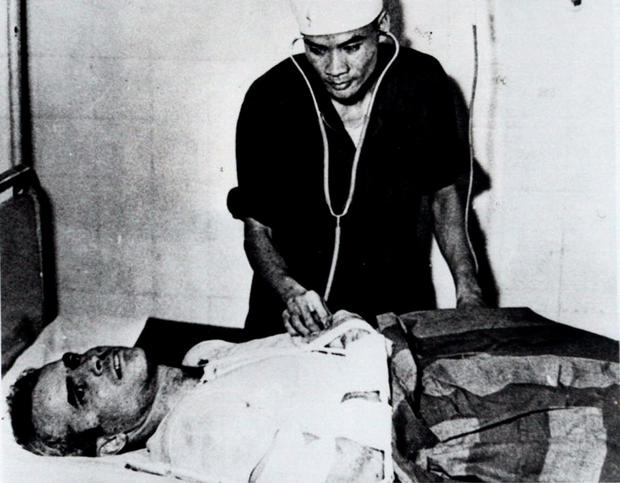 FILE - In this fall 1967 file photo, John McCain is administered to at a Hanoi, Vietnam hospital as a prisoner of war. (AP Photo/File)