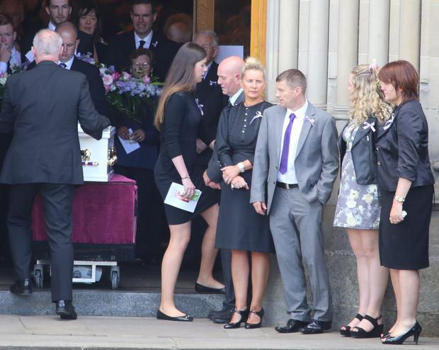 Tory Johnston's parents Sammy (Grey suit) and Helen with her sister Amy as her remains leave St Eunan's Cathedral Credit: North West Newspix