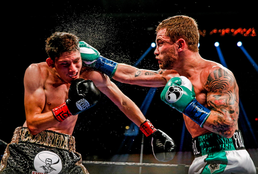 Carl Frampton, right, exchanges punches with Alejandro Gonzales Jr during their IBF Super-Bantamweight Title Fight