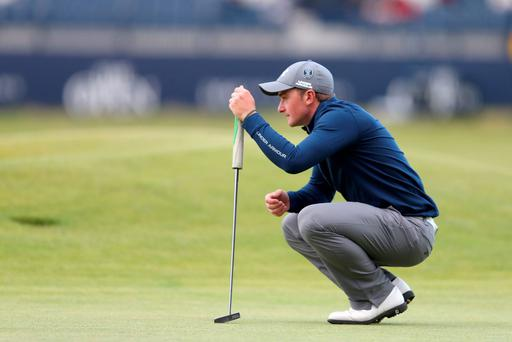 Ireland's Paul Dunne lines up a putt during day four of The Open Championship 2015 (PRESS ASSOCIATION Photo)