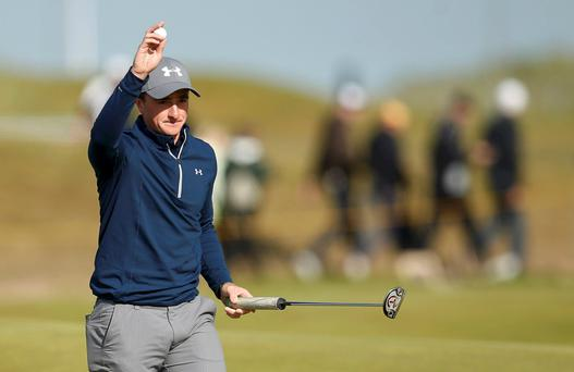 Paul Dunne reacts after his birdie putt on the 15th hole Credit: Lee Smith